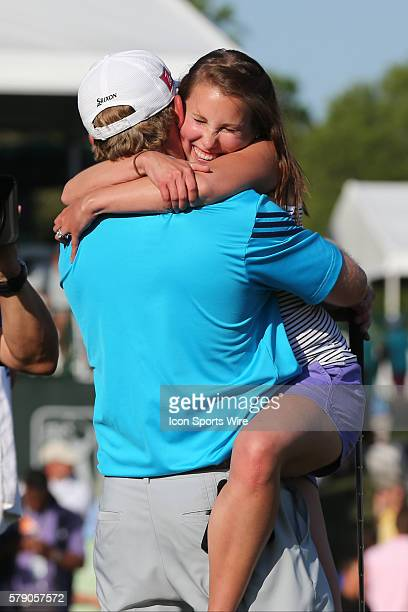 JB Holmes wife Sara jumps into his arms after his win during third round action at the the Wells Fargo Championship Tournament at Quail Hollow...