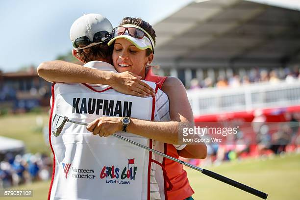 Kim Kaufman hugs her caddie after her putt on during the final round of the North Texas LPGA Shootout played at the Las Colinas Country Club in...