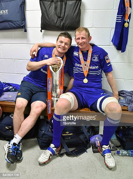 May 2014; Leinster players Brian O'Driscoll and Leo Cullen, right, celebrate with the trophy after the game. Celtic League 2013/14 Grand Final,...
