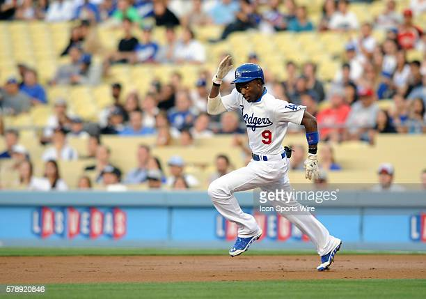 Los Angeles Dodgers Second base Dee Gordon [7422] rounds first on his way to second for a double during a Major League Baseball game between the...