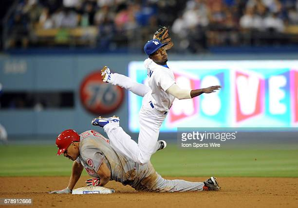 Los Angeles Dodgers Second base Dee Gordon [7422] turns to first and leaps over Cincinnati Reds First base Donald Lutz [9583] to attempt a double...