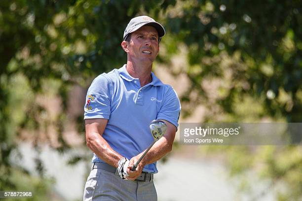 Mike Weir of Canada reacts to his opening tee shot on during the final round of the HP Byron Nelson Championship held at the TPC Four Seasons Resort...