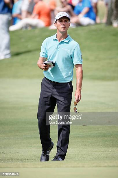 Mike Weir of Canada walks 99 yards up to the green before his third shot on during the 3rd round of the HP Byron Nelson Championship held at the TPC...