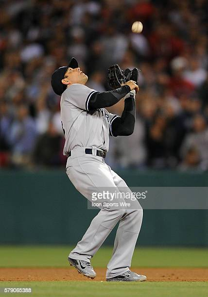 New York Yankees second baseman Brian Roberts catches the last out of a game against the Los Angeles Angels of Anaheim played at Angel Stadium of...