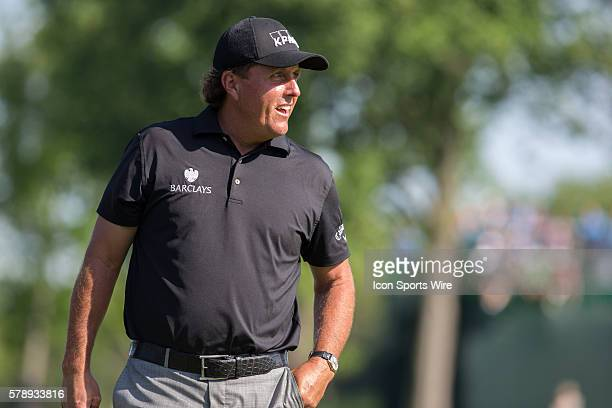 Phil Mickelson cracks a smile after a shot on hole 15 during the second round of the Memorial Tournament held at the Muirfield Village Golf Club in...