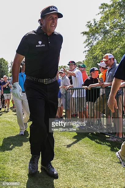 Phil Mickelson heads towards the walk to as fans cheer during third round action at the the Wells Fargo Championship Tournament at Quail Hollow...