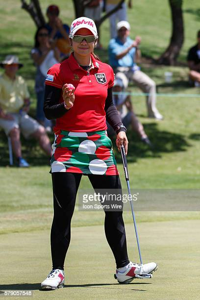 Pornanong Phatlum of Thailand sinks her birdie putt on during the final round of the North Texas LPGA Shootout played at the Las Colinas Country Club...