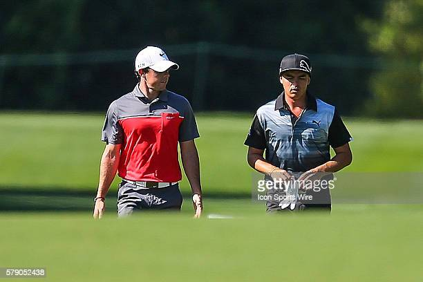 Rory McElroy and Rickie Fowler talk as they proceed up the fairway during third round action at the the Wells Fargo Championship Tournament at Quail...
