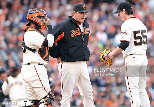 San Francisco Giants pitching coach Dave Righetti and Giants catcher Hector Sanchez go to the mound to settle down Tim Lincecum after Lincecum...