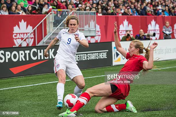 May 2014 Team USA's Heather O'Reilly is stopped by Team Canada's Rebecca Quinn during the USA v Canada game at the Investors Group Field in Winnipeg...