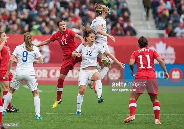 May 2014 Team USA's Lauren Holiday and Team Canada's Christine Sinclair during the USA v Canada game at the Investors Group Field in Winnipeg MB.