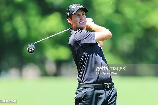 Webb Simpson watches his approach shot during third round action at the the Wells Fargo Championship Tournament at Quail Hollow Country Club...