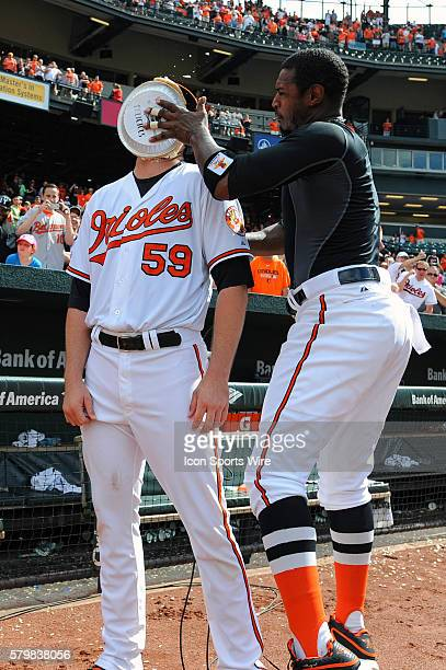 Baltimore Orioles center fielder Adam Jones puts a pie in the face of Baltimore Orioles starting pitcher Mike Wright after win in his major league...
