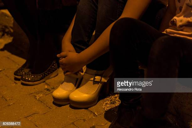 17 May 2015 Bozüyük Turkey One of the three children of Emine Bass plays with the shoes of a volunteer of the Platform 'KADIN CINAYETLERINI...
