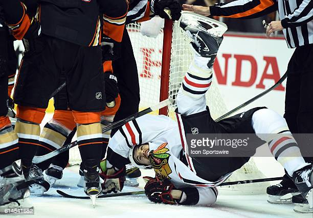 Chicago Blackhawks Right Wing Andrew Shaw [8702] is yanked to the ice by Anaheim Ducks Center Rickard Rakell [9023] after a stoppage in play during...