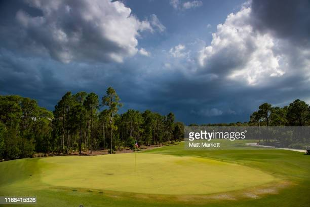Dark skies hang over the 18th green at the Concession Golf Club in Bradenton, Florida during a weather delay. Emma Talley of the University of...