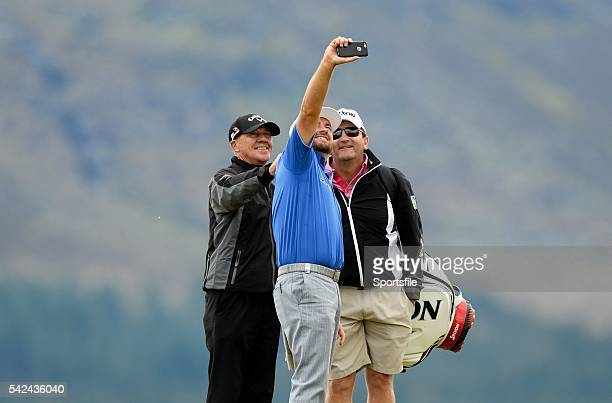 25 May 2015 Graeme McDowell taking a selfie of himself with coach Pete Cowen left and Ken Comboy Caddie right during a practice round Dubai Duty Free...