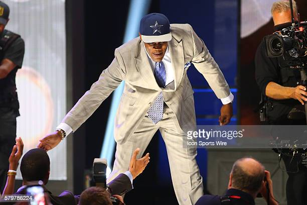 Randy Gregory High Fives the Fans after being chosen by the Dallas Cowboys with the 60th pick during round 2 of the 2015 The NFL Draft is being held...