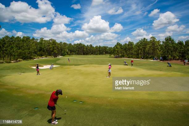 University of Southern California's Annie Park chips onto the green during play at theDivision I Women's Golf Championship. Emma Talley of the...