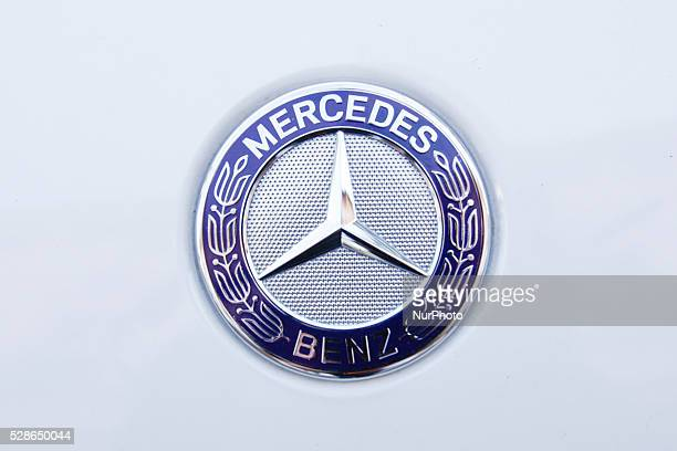 May 2016 A Mercedes logo is seen on a parked car Daimler the maker of Mercedes cars will build its first factory in Poland producing four cylinder...
