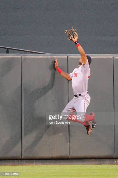 Boston Red Sox left fielder Chris Young makes a catch against the Baltimore Orioles at Orioles Park at Camden Yards in Baltimore MD where the Boston...