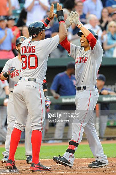 Boston Red Sox right fielder Mookie Betts is congratulated by left fielder Chris Young after hitting a 3run home run in the second inning against the...