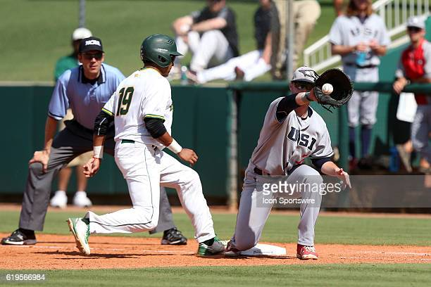 Cal Poly Pomona's Jared James beats a pickoff throw to SIU's Andrew Cope The Cal Poly Pomona Broncos played the Southern Indiana Eagles in Game 2 of...