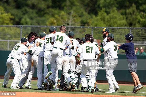 Cal Poly Pomona's players celebrate at the end of the game The Cal Poly Pomona Broncos played the Southern Indiana Eagles in Game 2 of the 2016 NCAA...