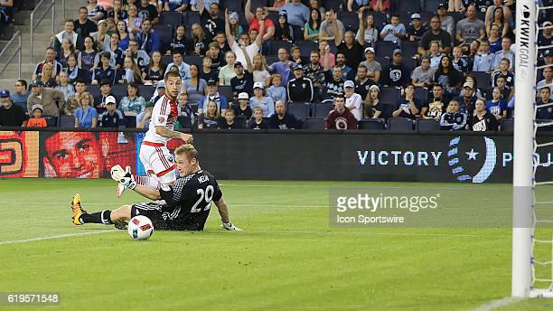 DC United midfielder Luciano Acosta gets a shot past Sporting Kansas City goalkeeper Tim Melia but was called offsides in a match between DC United...