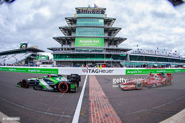 IndyCar driver Conor Daly and IndyCar driver Graham Rahal go start finish line and the Pagoda during the running of the Angie's List Grand Prix of...