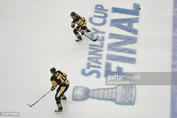 Pittsburgh Penguins center Evgeni Malkin and center Sidney Crosby skate across the Stanley Cup Final logo before Game One in the 2016 NHL Stanley Cup...