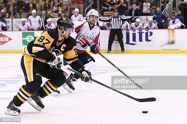 Pittsburgh Penguins center Sidney Crosby brings the puck in to the zone as Washington Capitals defenseman Matt Niskanen defends during the third...