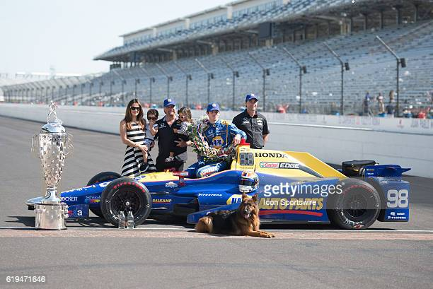 Race winner Alexander Rossi with team owners Bryan Herta Michael Andretti Michael's wife Jodi Ann and their children and dog at the Day After Photo...
