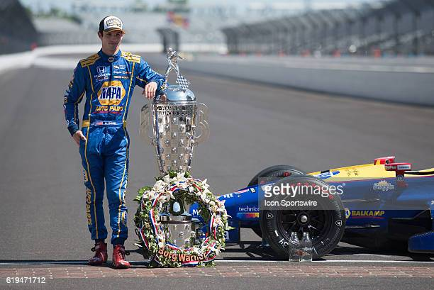 Race winner Alexander Rossi with the BorgWarner Trophy and his winning car at the Day After Photo Shoot for the 100th running of the Indianapolis 500...