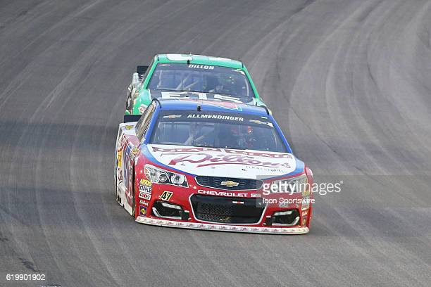Sprint Cup Series driver AJ Allmendinger is pursued by Austin Dillon during the NASCAR GoBowlingcom 400 Sprint Cup Series race at Kansas Speedway in...