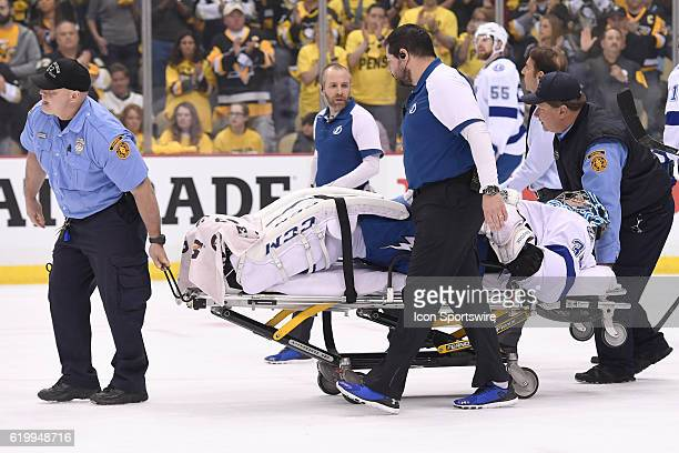 Tampa Bay Lightning goalie Ben Bishop leaves the ice on a stretcher after suffering an apparent injury during the first period of Game One in the...