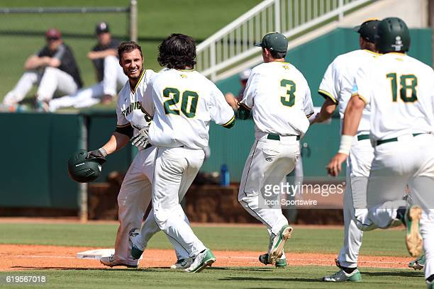 Teammates rush towards Cal Poly Pomona's Jason Padlo after he drove in the gamewinning run The Cal Poly Pomona Broncos played the Southern Indiana...