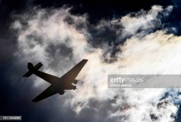 A historical Junkers Ju 52 plane flies over Cologne against the light Up to 20 people have died in a plane crash in the Swiss Alps on Saturday The...