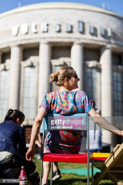 May 2018, Berlin, Germany: A participant of the demonstrations infront of the Berlin Volksbuehne, in order to decide upon its future, sitting on a...