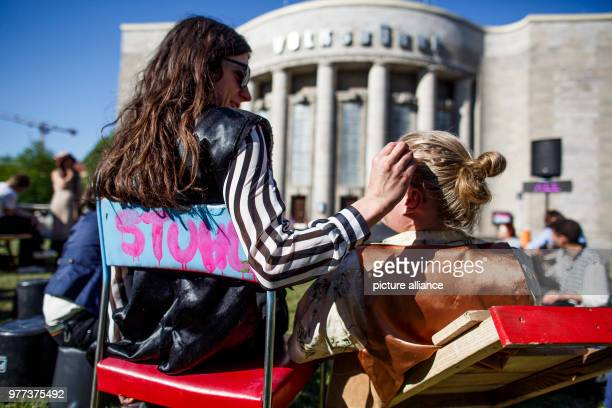 May 2018, Berlin, Germany: Two Participants of the demonstrations infront of the Berlin Volksbuehne, in order to decide upon its future. A group of...