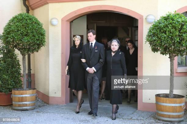 Duchess Marie of Wuerttemberg her son Duke Wilhelm of Wuerttemberg and Duchess Diane of Wuerttemberg leave the church Photo Thomas Warnack/dpa