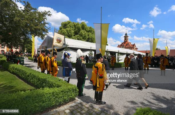 Funeral guests walk past guardsmen after the service Photo KarlJosef Hildenbrand/dpa