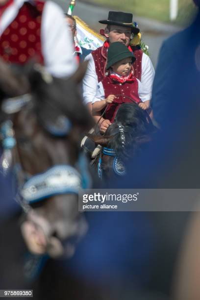 Participants of the Whit Monday procession ride their horses This event counting with almost 900 participants belongs to one of the oldest Bavarian...