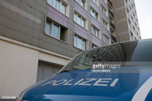 A German patrol car standing in front of a residence at the ErichKurzStrasse About 200 officers of the German federal and state police force took...