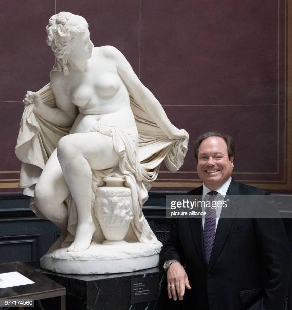 Before a press conference the president of the MosseFoundation Roger Strauch stands beside the sculpture Susannaby Reinhold Begas which is from the...