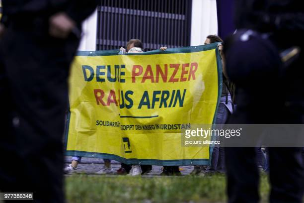 """May 2018, Germany, Berlin: Participants of a demonstration by the interventionist Left with the slogan """"Out with Rheinmetall - No deals with Erdogan,..."""