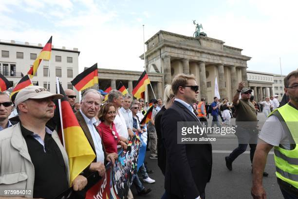 Supporters of the party Alternative for Germany protest under the slogan 'Zukunft Deutschland ' Among them are prominent members such as AfDspokesmen...