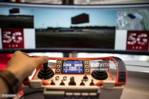 A remote control for a 200 ton crane standing in the Vodafone 5G Lab All devices capable of 5G are tested and certified for the Vodafone network at...
