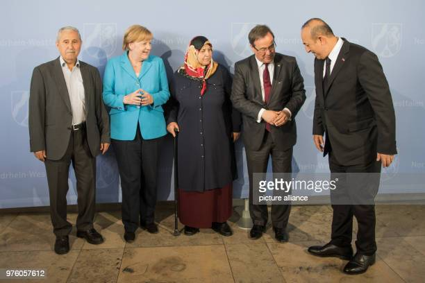 May 2018, Germany, Duesseldorf: Durmus Genc , the German Chancellor Angela Merkel of the Christian Democratic Union , Mevlude Genc, mother,...