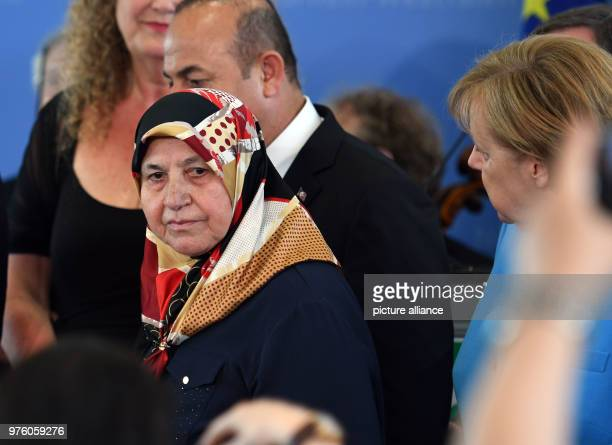 Mevlude Genc mother grandmother and aunt of victims attending a memorial service for the arson attack in Solingen with German Chancellor Angela...